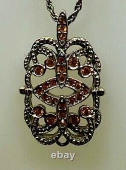 Chaîne plus pendentif. Vintage Dior signés les 2, jamais portés